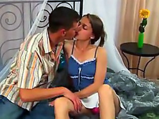 Teen brunette makes love with her man
