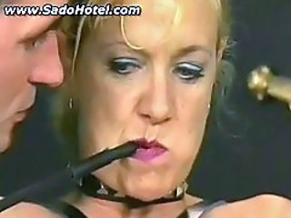 Mature slave getting tits and pussy whipped