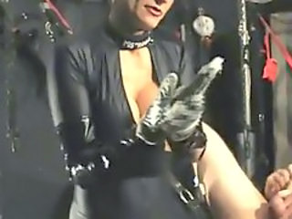 Mistress in black latex catsuit fist fucks with both hands while the slave gave himself a handjob