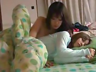 Sleeping Japanese girl has tits licked