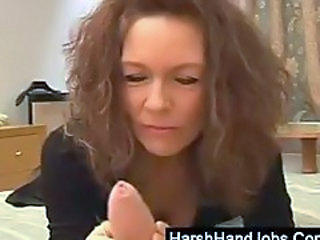 Mature brunette gives a harsh handjob