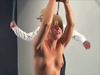 Crazy dude whipping a poor small titted blonde
