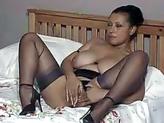 Busty bitch in stockings petting her cunt