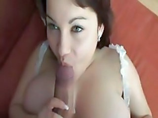 Natural busty brunette sucks and fucks cock for a warm facial