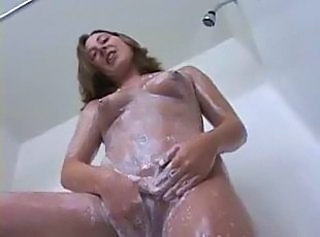 Solo girl showering and rubbing clit