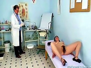 Karin gets speculum inserted deep inside her hairy pussy