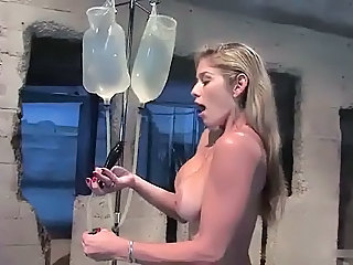 Anal Squirting, Busty Blonde Fills Ass With Buttplug Enema