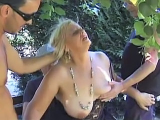 Mature blonde dp'd in park