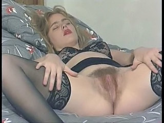 British hairy slut plays with...