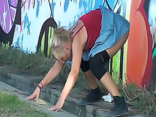 drunk girl pissing after party on public