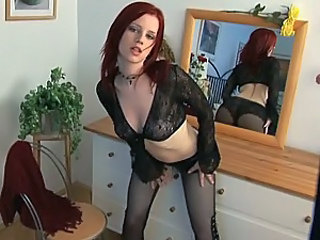 Horny Redhead Rubs Her Shaved Pussy In Front Of A Mirror