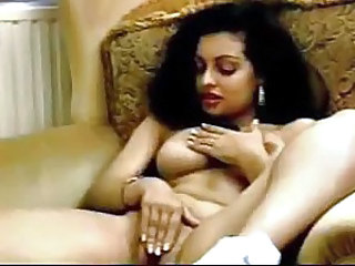 Solo busty Arab gal plays with pussy