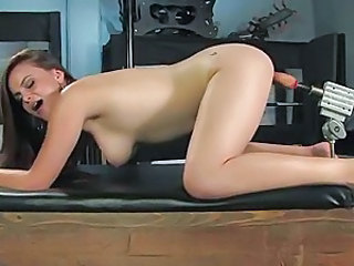 Slutty bitch takes a pumping fuck machine hard up her hot wet pussy hole