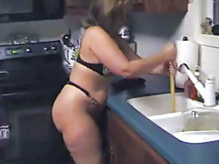Mature babe using a plunger