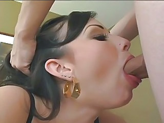 Filthy luscious Jennifer White stuffs her mouth with a beefy angry cock