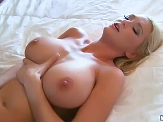 Delightful blonde Blake Rose with perfect huge tits gets her pussy drilled by long black cock of skinny chocolate guy Sean Michaels on the edge of the bed with her legs apart.