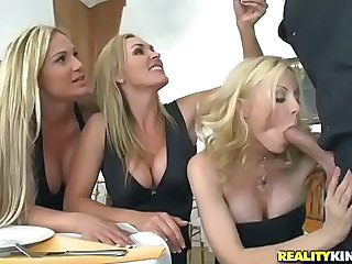 Three beautiful milfy blondes Tyler Faith. Holly Sampson and Tanya Tate are very curious about waiter Vooddoo and his big cock. They pull out his sausage and turn dinner into CFNM orgy! They blow. stroke and ride his big cock with passion!