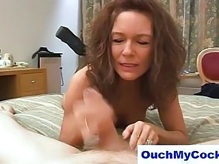 Cougar gives hotel guy a harsh handjob