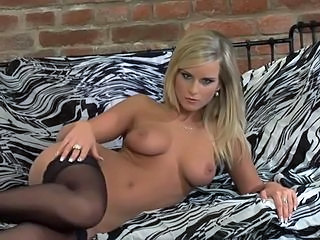 Blonde babe in stockings stripping