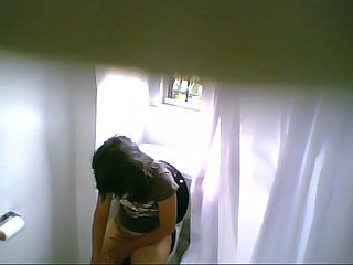 Bathroom spycam on teen...