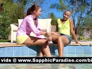Gorgeous brunette and blonde lesbians kissing and having lesbian sex by the pool