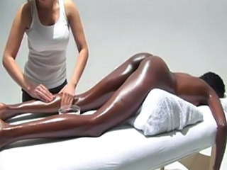 Hot ebony babe gets covered in body oil and receives a lesbian massage