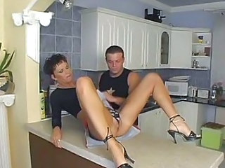 Short haired  does anal in kitchen
