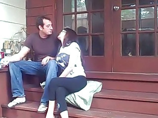 Couple having sex outdoors on the steps