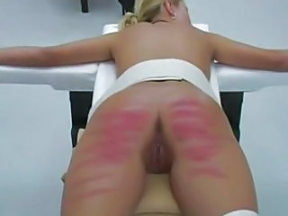 Teen women are strapped to a table and caned