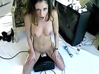 Perky tit girl rides Sybian and cums
