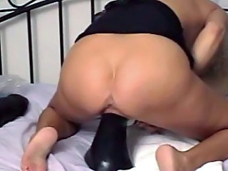 Milf stretches pussy with giant toys