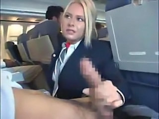 Stewardess gives a handy J on plane