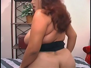 Curvy Latina rides dildo on...