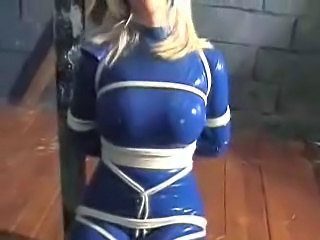 Blonde In Blue Latex Catsuit Bound