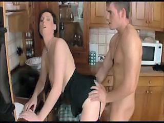 Brunette Mom Laura Has A Sexy Interlude With Her Young Neighbor In The Kitchen