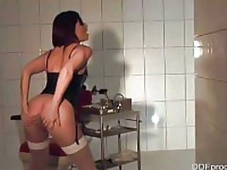 Speculum In Her Pussy While She Models Lingerie