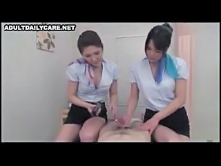 Two Asian Gals Are Taking Turns With His Cock In This Threesome