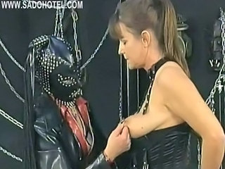 Masked Mistress Wearing Leather Mask Plays With Tits...