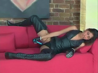 chick in leather plays with her pussy