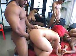 Depraved ebony couples gathered together for hot hardcore orgy