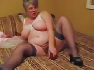 Fat granny fucks her pussy with toy