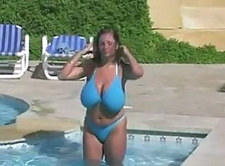 girls with boobs swimming in the pool _: big boobs