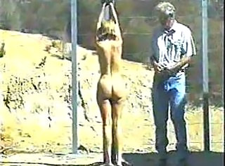Blonde Strung Up and Whipped Outdoors
