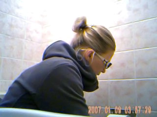 Nice young girl spied on toilet 3