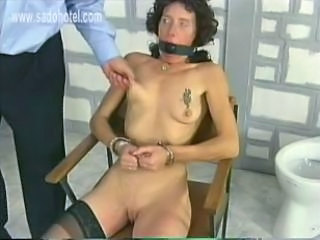 Dirty slave with a ball in her mouth got tied to chair in...