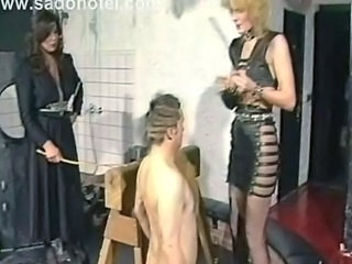 Dominatrix puts alot of needles to slave his balls and nipples other slave got spanked on her ass