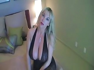 F60 Big Boobs MATURE IN NYLON CATSUIT