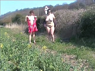 Public Flashing In A Field With A Friend