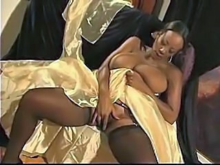 Busty African hottie is jilling off on the couch