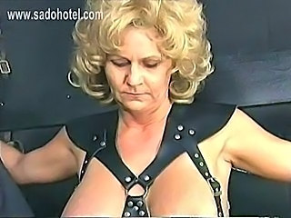 Older slave with big tits gets large metal clamps with heavy weights on her...